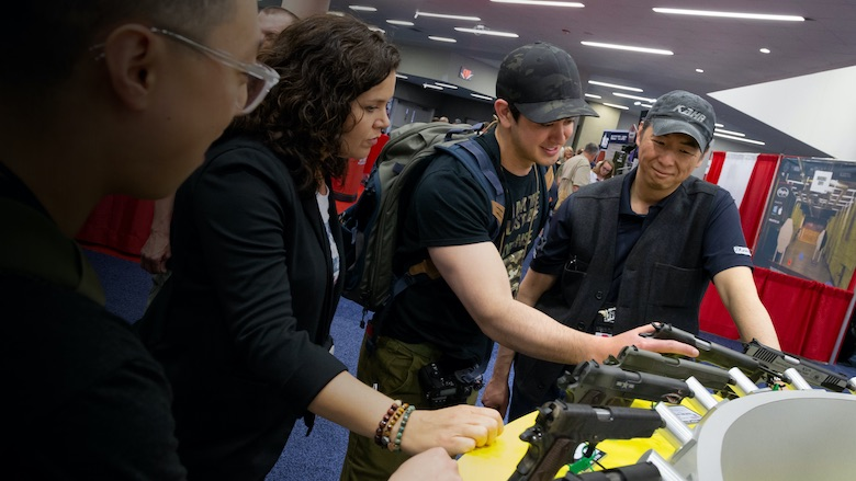 Inspecting handguns at the NRA Annual Meetings
